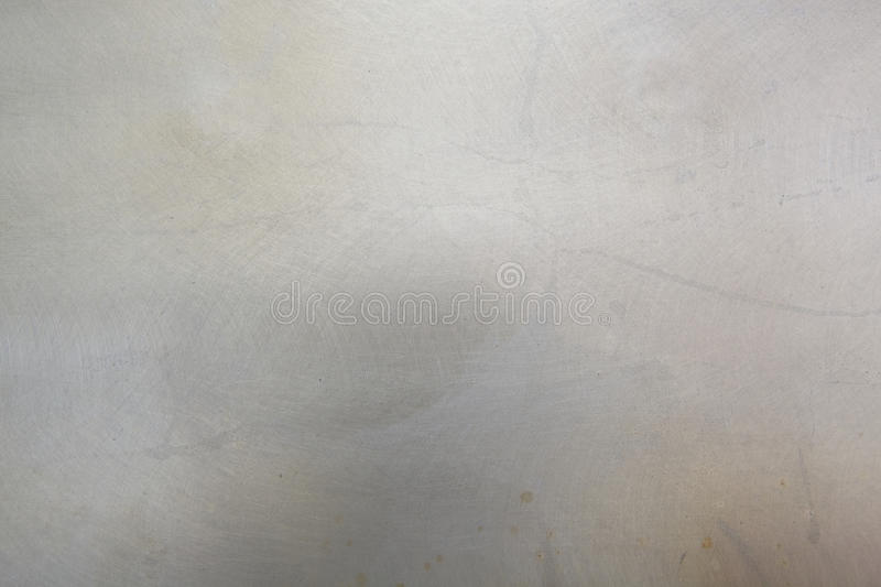 Scratched metal background. Light grey scratched metal background stock image
