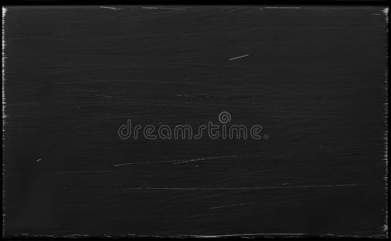 Scratched polished black metal texture stock photography