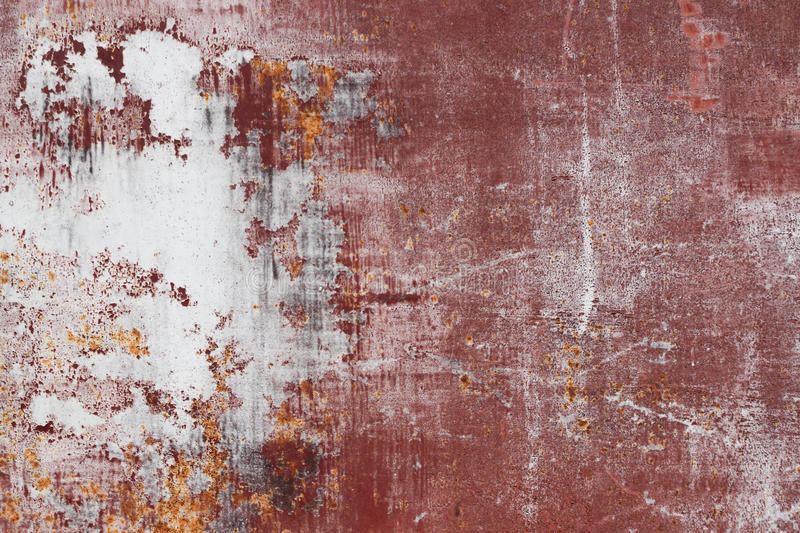Scratched red metal surface. Red scratched metal surface with peeling paint stock images