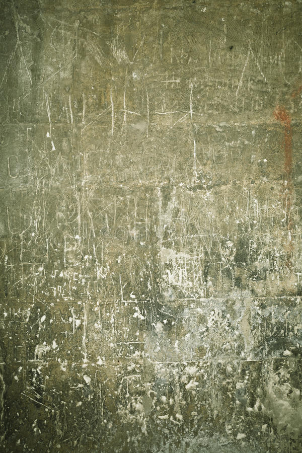 Scratched and smudged wall. Green scratched and smudged wall background in vibrant colors stock photography