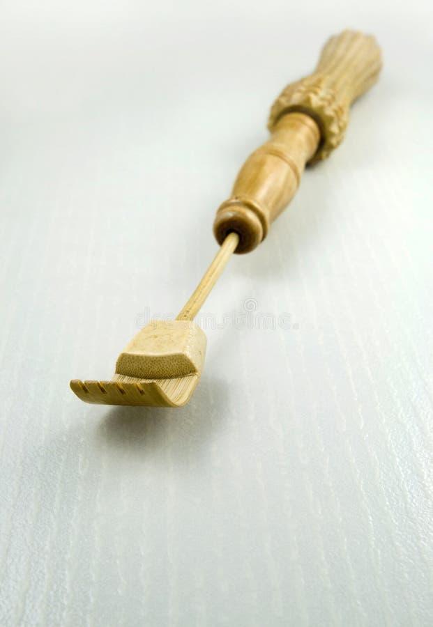 Scratcher posterior del bambú. imagen de archivo