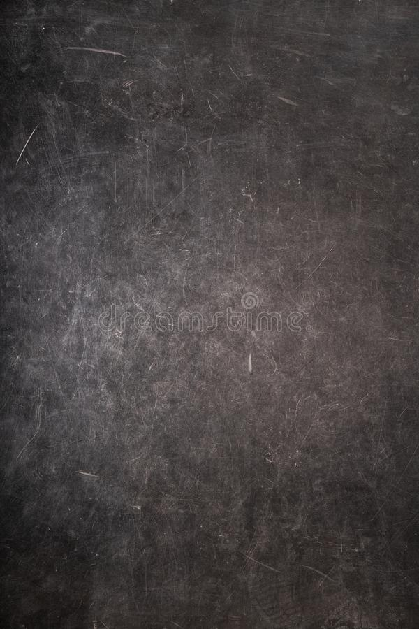 Scratches on a gray grungy surface stock photography