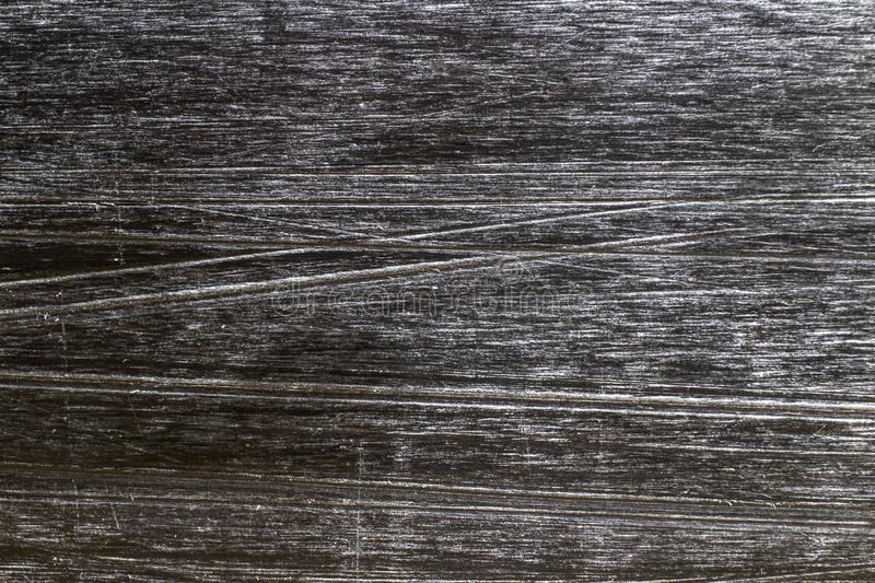 Scratches on the sliding surface of the snowboard close-up royalty free stock photography