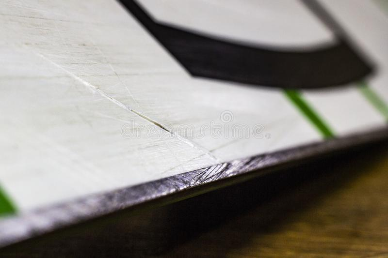 Scratches on the sliding surface of the snowboard close-up stock photo