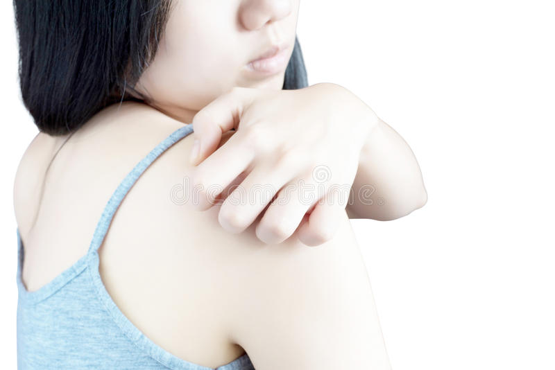 Scratching her arm or shoulder in a woman isolated on white background. Clipping path on white background. Scratching her arm or shoulder in a woman isolated on stock images