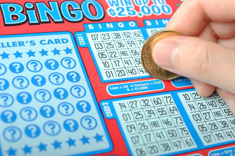Scratching a lottery ticket royalty free stock images