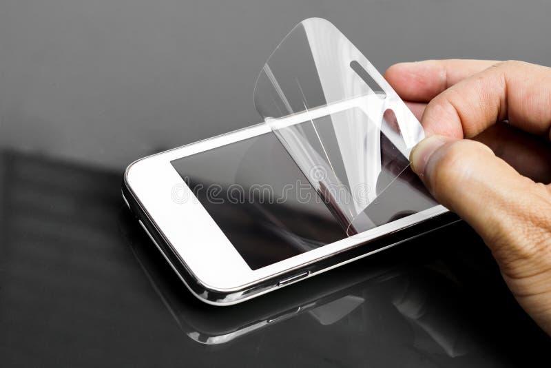 Scratchprooffilm op smartphone stock fotografie
