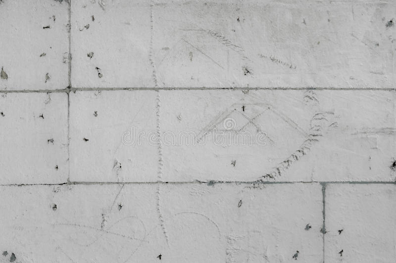 Scratchy greyscale styrofoam wall background with sketches royalty free stock photo