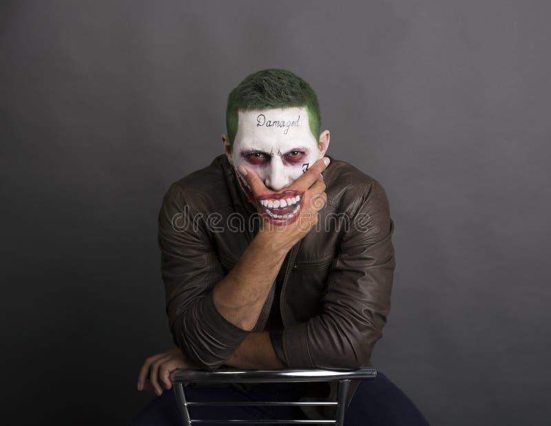 Screaing rampant foncé de visage de joker fâché Cheveux verts photos stock