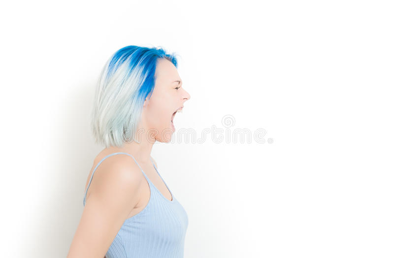 Scream of young hipster teen woman royalty free stock image