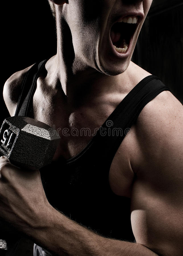Screaming Athlete with Muscles stock images