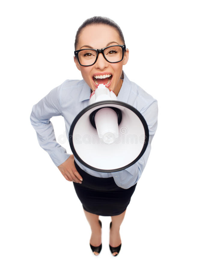 Screaming businesswoman with megaphone. Business and office concept - screaming businesswoman in eyeglasses with megaphone royalty free stock photography