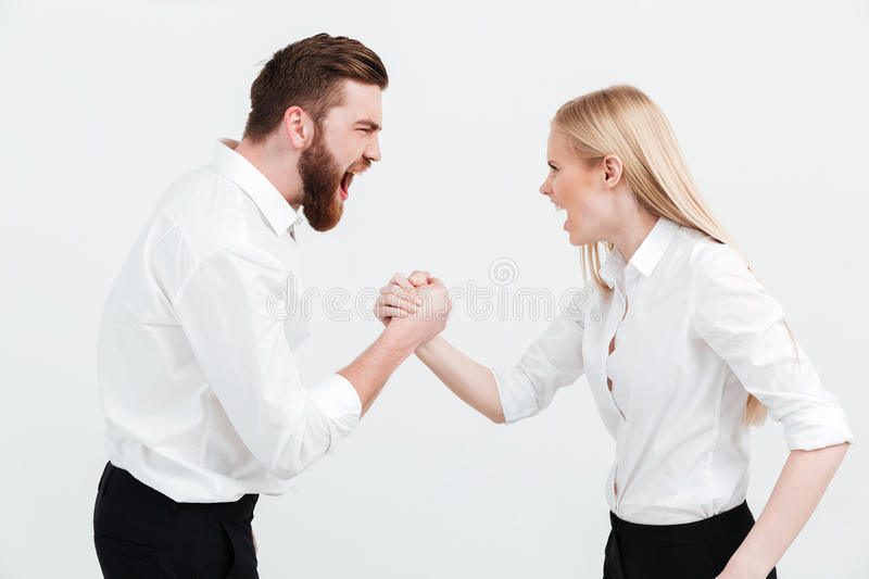 Screaming colleagues business team shaking hands. stock photo