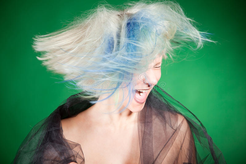 Screaming crazy girl with platinum hair. Portrait close up shot royalty free stock images