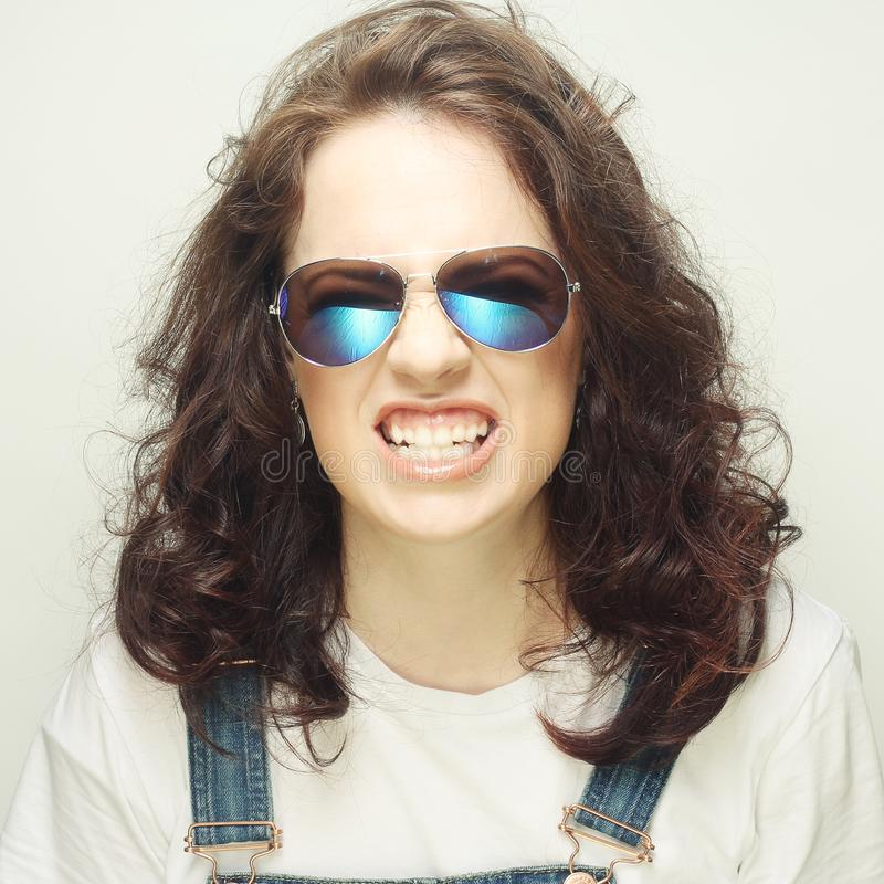 Screaming curly girl. With sunglasses stock photo