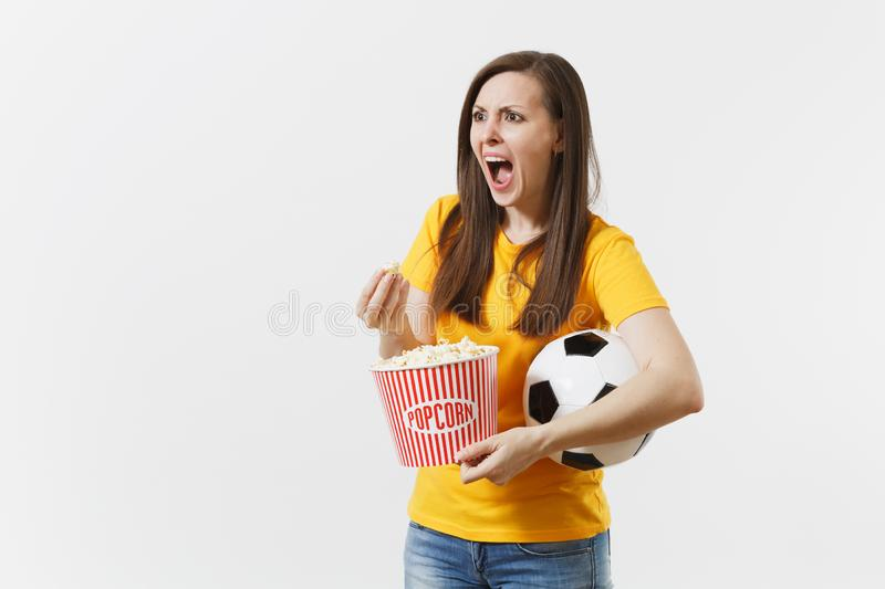 Screaming European woman, football fan holding soccer ball, bucket of popcorn upset of loss or goal of favorite team royalty free stock photos