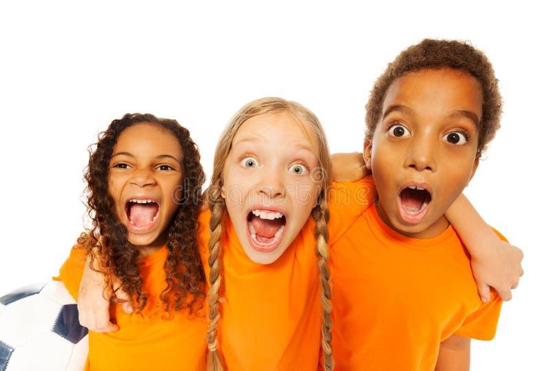 Screaming happy soccer team kids royalty free stock image