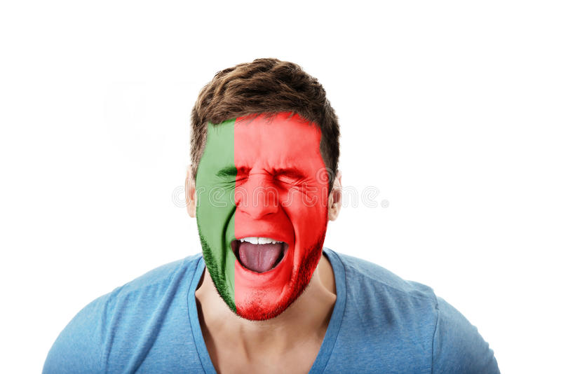 Screaming man with Portugal flag on face. royalty free stock photography