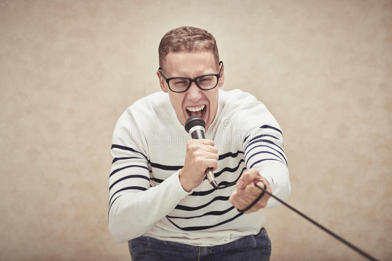 Screaming in microphone royalty free stock photography