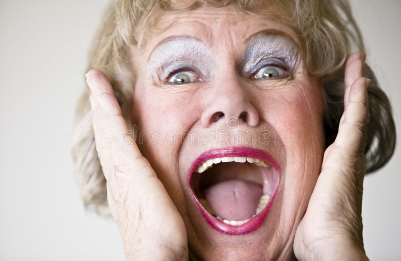 Screaming Senior Woman. Close-up of a senior woman with her mouth open screaming stock image
