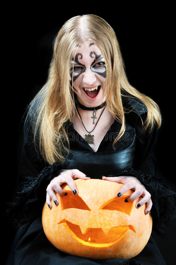 Free Screaming Vampire Girl With A Halloween Pumpkin Royalty Free Stock Photography - 6783697