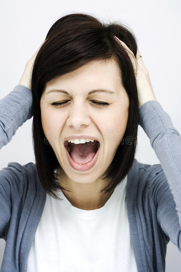 Screaming woman. Roar of a pretty young woman stock photography
