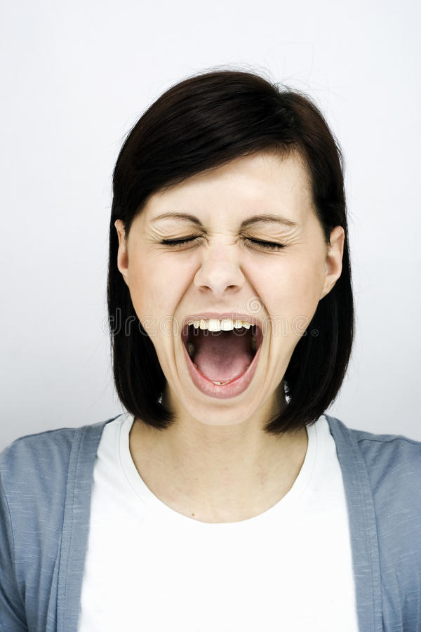 Screaming woman. Roar of a pretty young woman stock photos