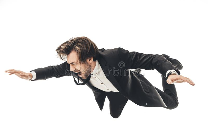 screaming young businessman in suit falling royalty free stock photo