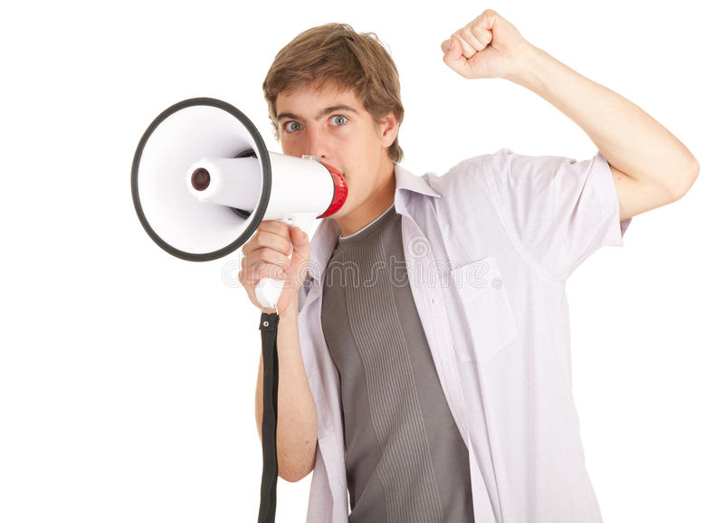 Screaming young man holding megaphone