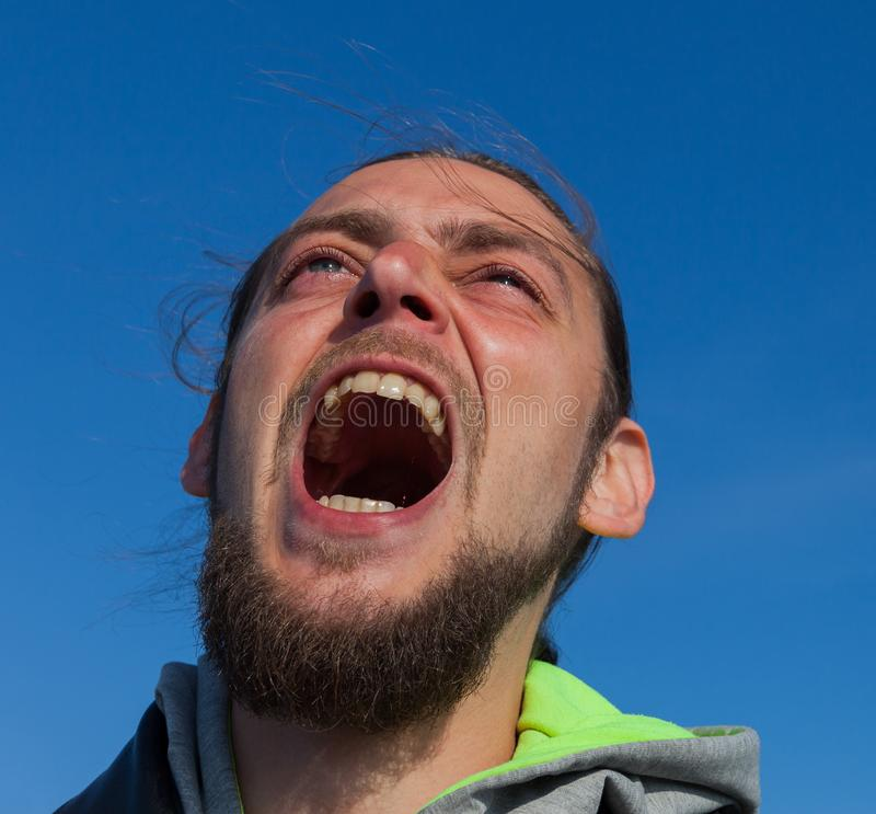 Screaming young man stock images