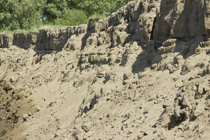 Scree of sand sand dunes, mountains, sand avalanche, texture, soil erosion, weathering royalty free stock photos