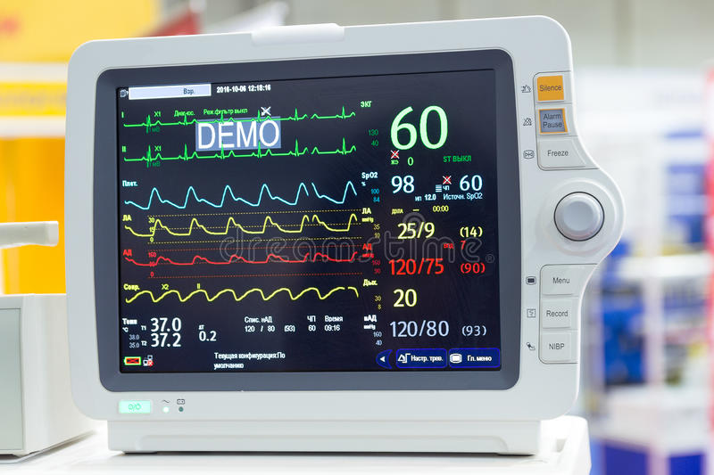 Screen of diagnostic medical equipment with indication of Cyrillic alphabet. Medicine stock photography