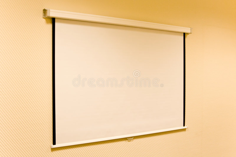 The screen for a projector on a wall of office.  royalty free stock photos