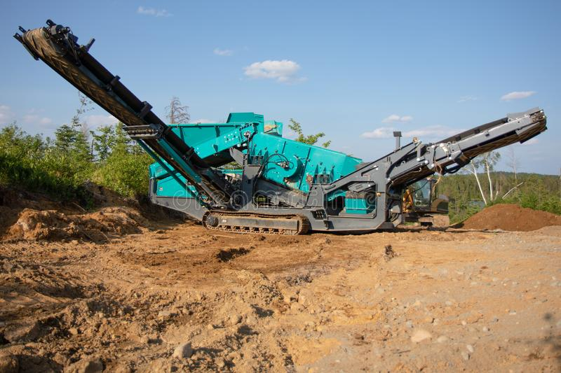 Screener Heavy Equipment Machine in the Summer on a Job Site stock photography