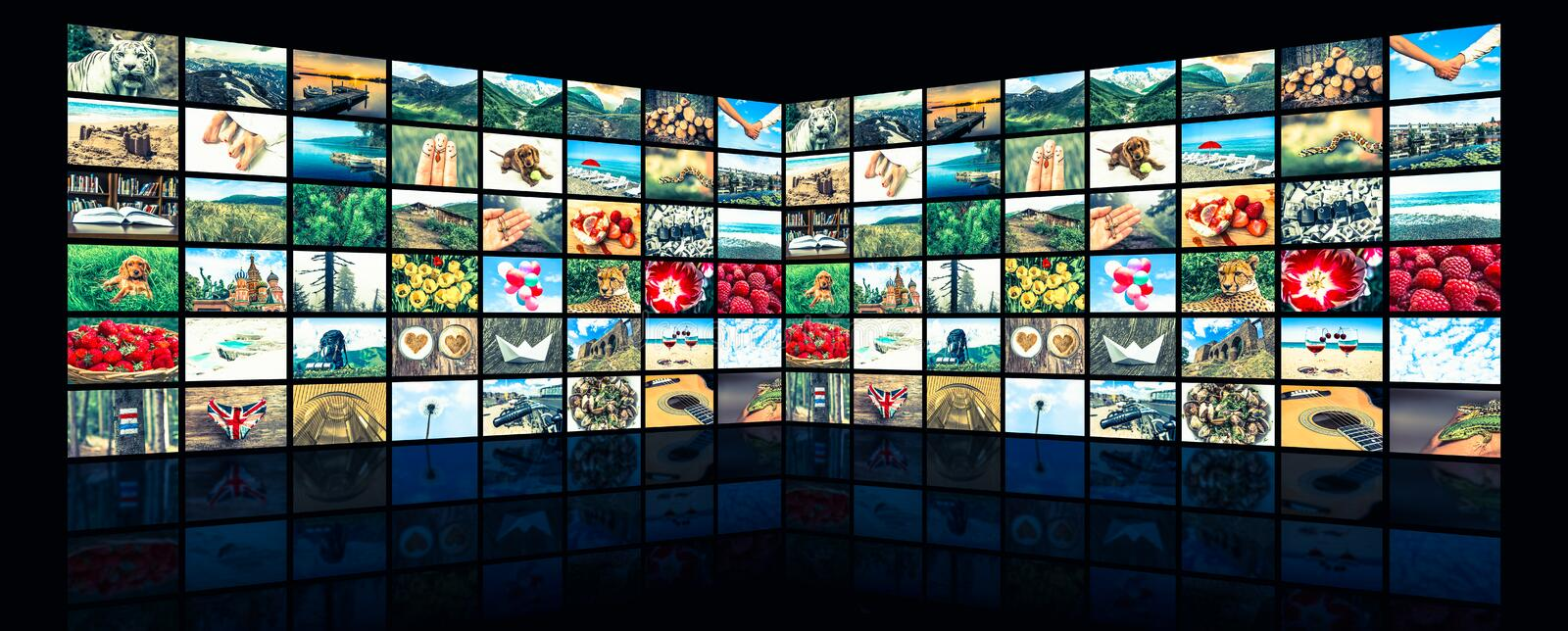 Screens forming a big multimedia broadcast video wall royalty free stock photos