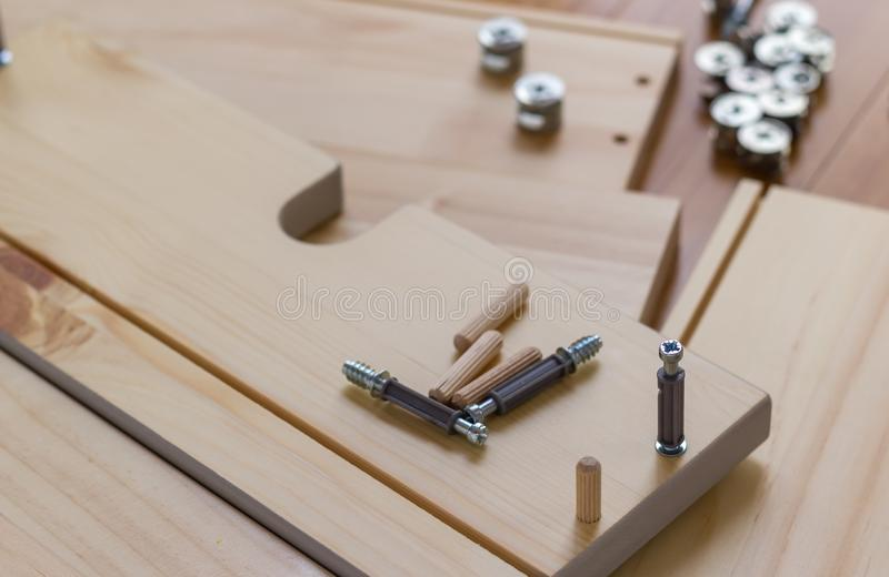 Screw being screwed into wood, copy space royalty free stock photo