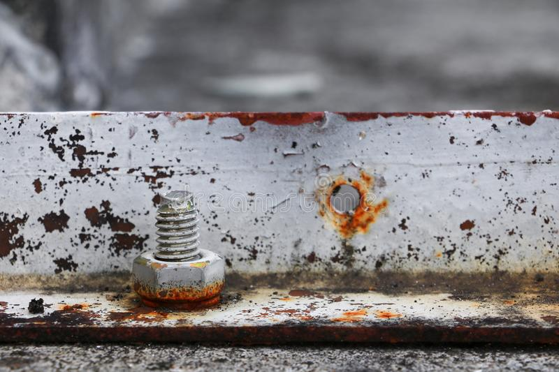 nut rusted sticking iron plate on concrete floor stock photos