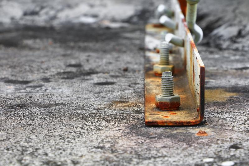 nut rusted sticking iron plate on concrete floor select focus with shallow depth of field royalty free stock photography