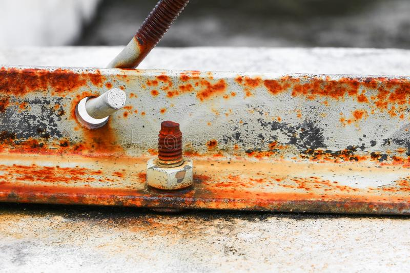 nut rusted sticking iron plate on concrete floor select focus with shallow depth of field stock photos