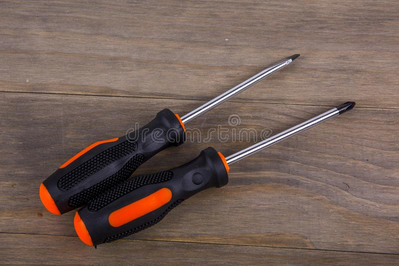 Screwdriver set. On Wooden background royalty free stock photos