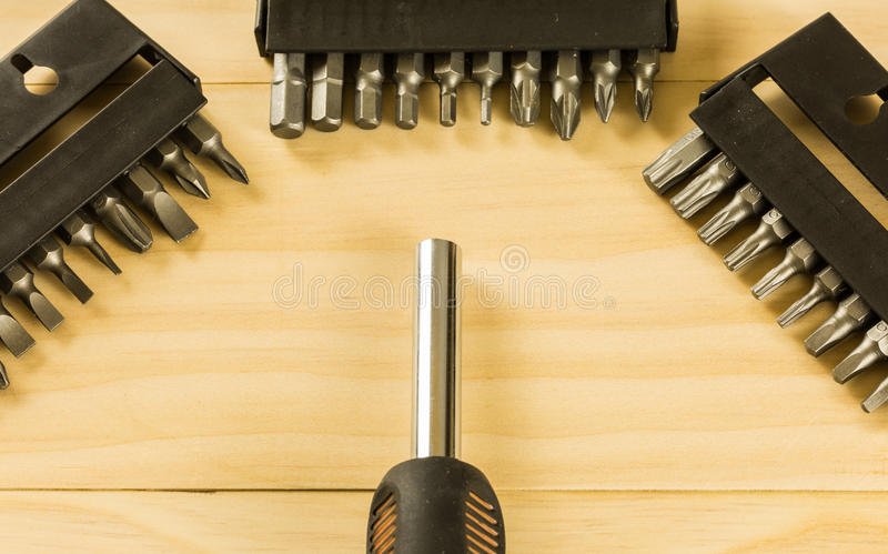 Screwdriver set. On wood table royalty free stock photo