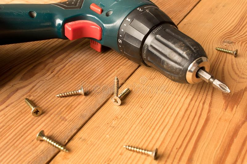 Screwdrivers and screws on a wooden table. The concept of work. Labor day.  royalty free stock photos