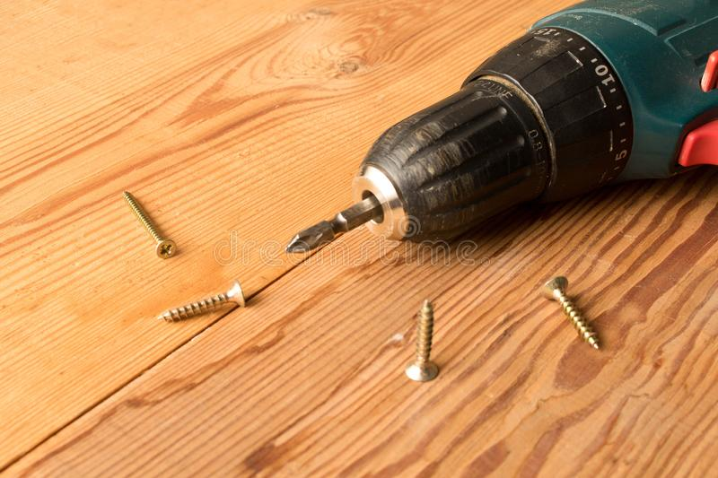 Screwdrivers and screws on a wooden table. The concept of work. Labor day.  royalty free stock photo