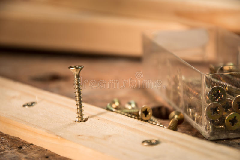Download Screws In A Board Stock Photos - Image: 26308013