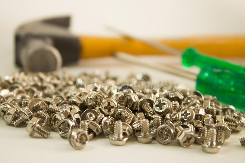 Screws, hammer and screwdriver stock images