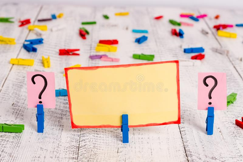 Scribbled and crumbling papers with paper clips placed on the wooden table. Stationary plus writing tools above classic. Scribbled and crumbling sheet with paper stock photos