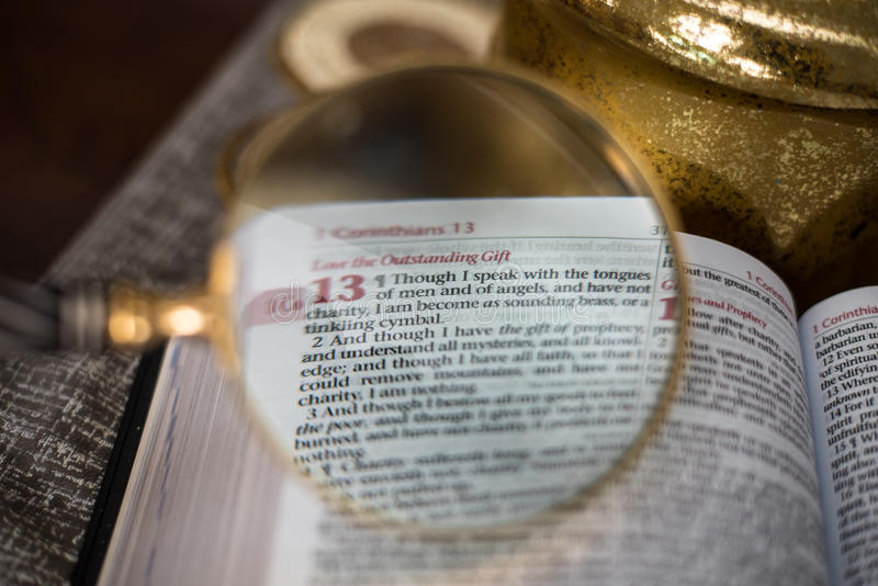 Scripture Reading with magnify glass. 1 corinthians 13 royalty free stock photos