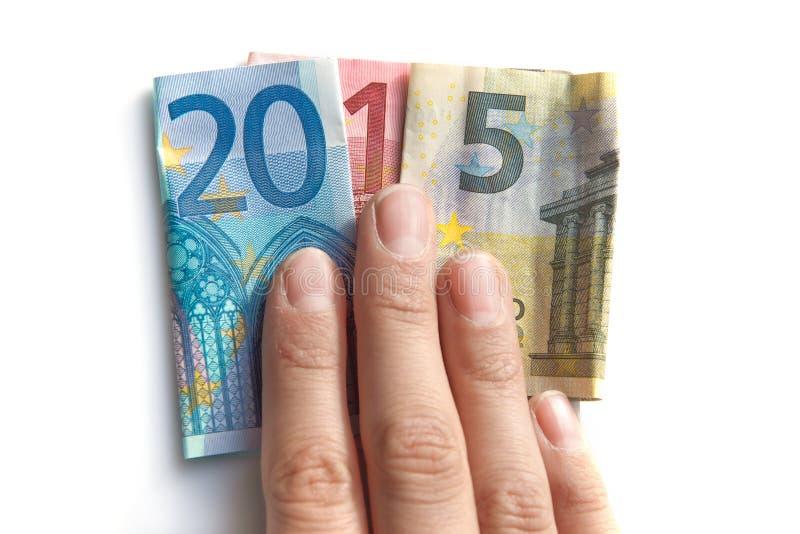 2015 scritto con le banconote degli euro in una mano immagine stock libera da diritti