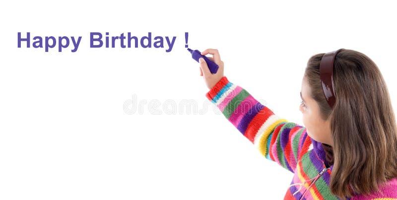 Scrittura adorabile della ragazza con la nascita felice fluorescente immagini stock