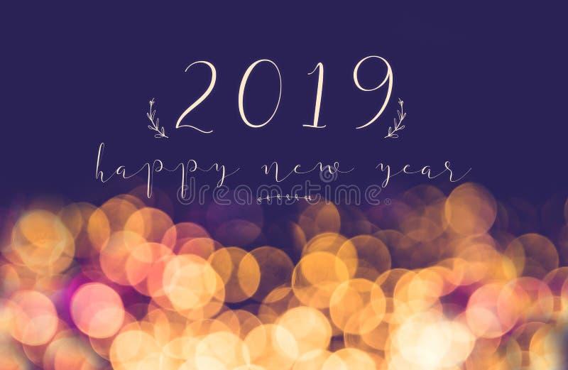 Scrittura 2019 buoni anni sul Li festivo del bokeh della sfuocatura d'annata immagini stock